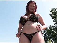 Curvy redhead in sexy black bikini..