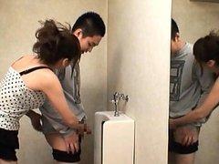 Yuma Asami in a public bathroom with a..