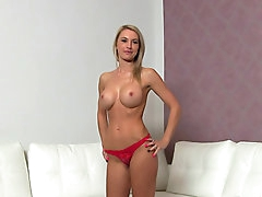 Blonde beauty shows her fake tits and..