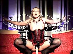 Glamorous slut wearing a corset bangs..