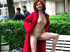 Curly redhead posing nude in public