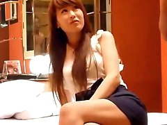 Redhead Asian amateur takes off her bra