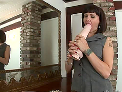 Horny Carrie Ann toys her tight pussy..