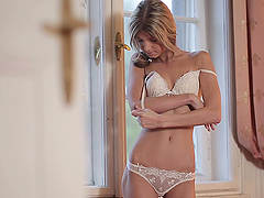 Blonde beauty Doris Ivy strips and..