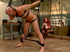 Chad Rock is hogtied and suspended so..