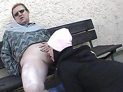 Renate gives a deep blowjob outdoors