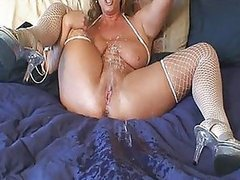 Horny Mature Blonde Fucks Her Shaved..
