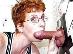 Mature redhead sucks dick through a..