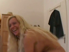 Long-haired blonde girl fondles..