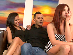 Two lustful girls ride an Asian dick and get facialed