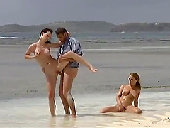 Elena and Rita Neri get fucked on a beach in FFM video