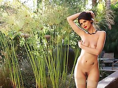 Erotic model Zoi gets naked in the..