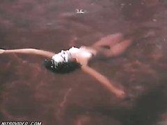 Delia Casanova Floating Naked in the..