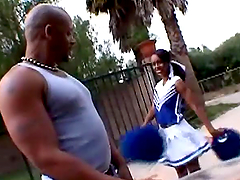 Stunning ebony cheerleader moans with..