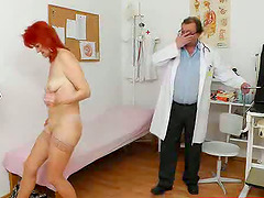 Redhead mature woman gets toyed by her gynecologist