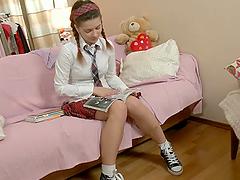 Adorable schoolgirl Lara masturbates..