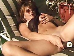 Brandi stroking her vag in outdoor