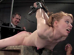 One is hogtied on the box and the..