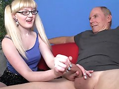 Young blonde stroking a fat cock
