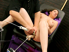 Horny brunette MILF gets toyed rough..