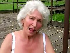 Horny Granny Rubs Her Cunt Outdoor..