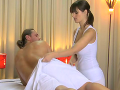 Big-breasted brunette gives massage..