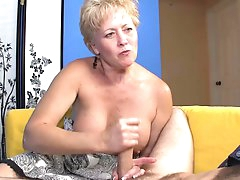 Cute short-haired mature is wanking a..