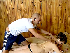 Mature lady enjoys massage and gets fucked in a sauna