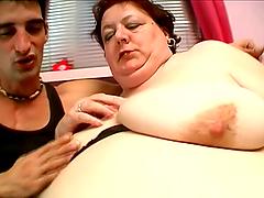 Mature tubby Agnes Eva sucks a cock..