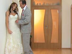 Sexy woman in wedding dress enjoys..