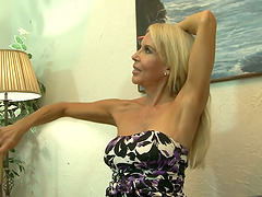 Mature blonde Erica Lauren lets a..