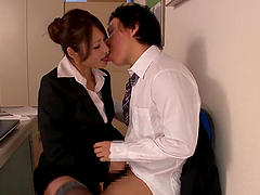 Office girl Risa Kotani gives a..