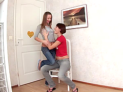 Two sizzling lesbian girls toying each..