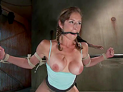Busty angel is facing a severe device..