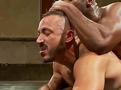 Interracial gay sex with two muscled..