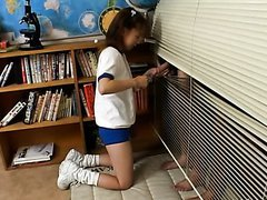 Cute Pigtailed Asian Teen Giving a..