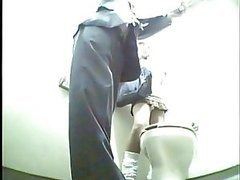 Guy and Girl Caught Sharing a Toilet By a Spy Cam
