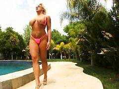 Bikini Wearing Alexis Golden Has..