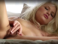 Blonde Anikka Albrite is drinking a tea