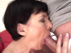 Busty mature Margo T fucks at the..