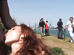 Hot Redhead Gives a Blowjob In Public..