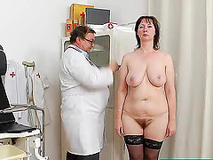 A mature woman in stockings gets..