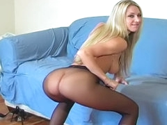 Sexy blonde with juicy ass playing with her nylons