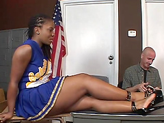 Ebony cheerleader is fucked by her..