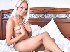 Blonde Jesica Ann lying in her bed..