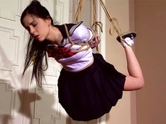 Tied schoolgirl Amber Nevada being..