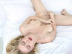 Alluring blonde Brookie Little lying..