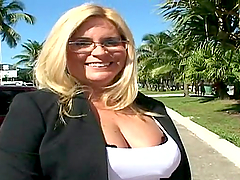 A curvy MILF in glasses rides a dick..