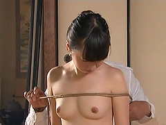 A slim Japanese girl gets tied up and..