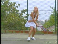 Two cute girls in tennis dresses have..